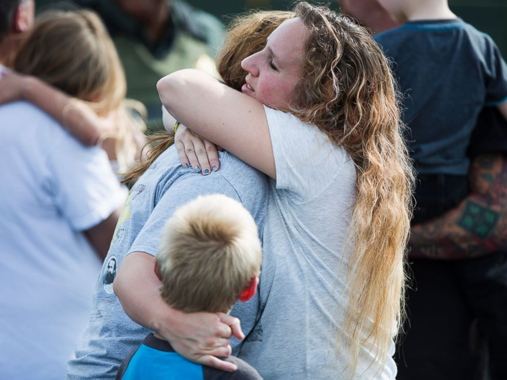 PHOTO: Korrie Bennett hugs Heather Bailey after recovering their children following a shooting at Townville Elementary in Townville, Sept. 28, 2016.