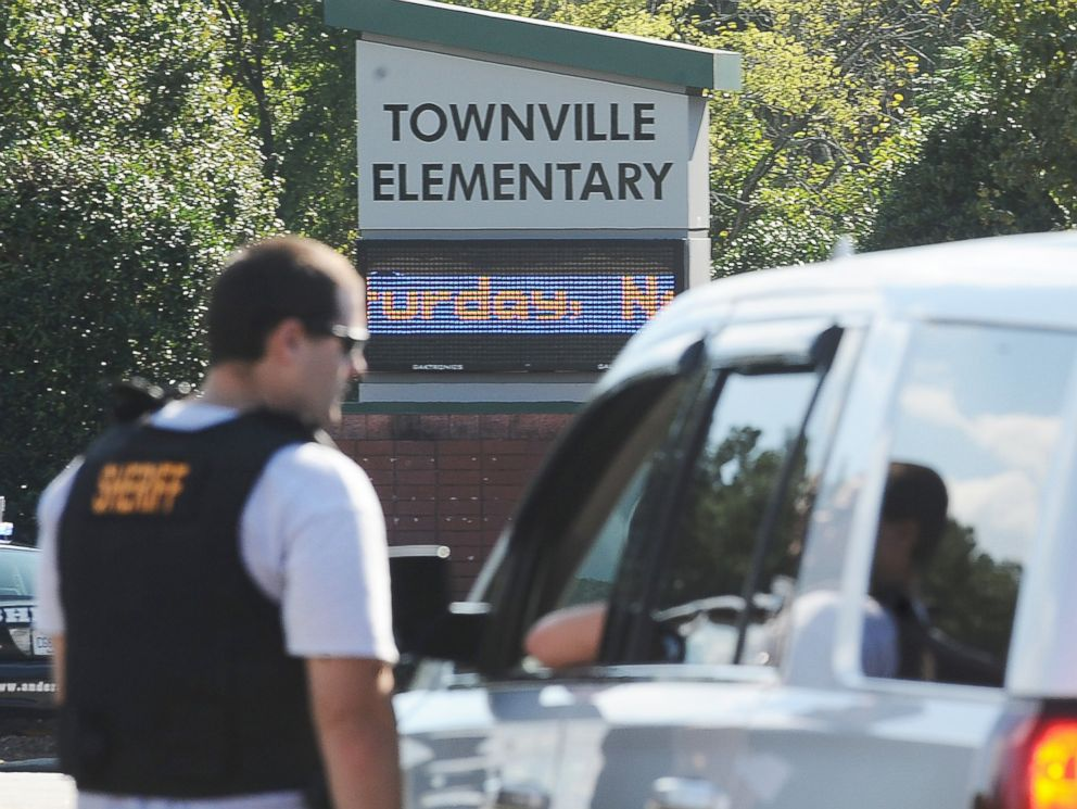 PHOTO: Members of law enforcement talk in front of Townville Elementary School, Sept. 28, 2016, in Townville, S.C.