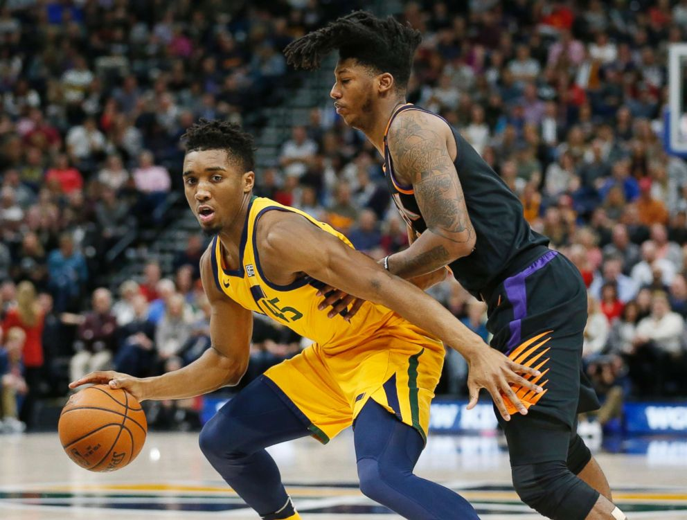 PHOTO: Phoenix Suns guard Elfrid Payton, right, guards Utah Jazz guard Donovan Mitchell, left, in the first half during an NBA basketball game Wednesday, Feb. 14, 2018, in Salt Lake City.