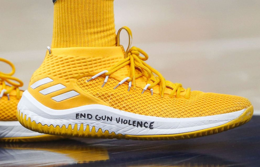 PHOTO: Utah Jazz guard Donovan Mitchell wears a shoe with End gun violence written on it, during the second half of the teams NBA basketball game against the Phoenix Suns on Wednesday, Feb. 14, 2018, in Salt Lake City.