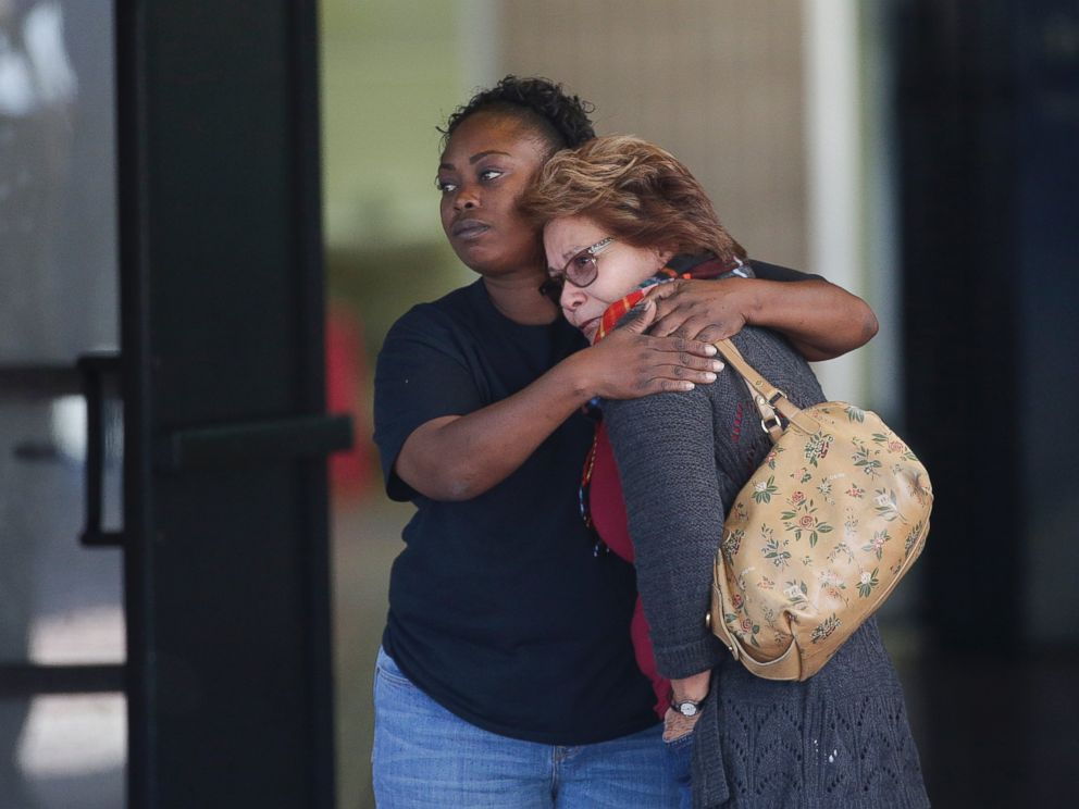 PHOTO: Two women embrace at a community center where family members are gathering to pick up survivors after a shooting rampage that killed multiple people and wounded others at a social services center in San Bernardino, Calif., Dec. 2, 2015.