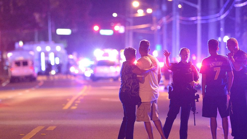 Orlando Police officers direct family members away from a multiple shooting at a nightclub in Orlando, Fla., Sunday, June 12, 2016.