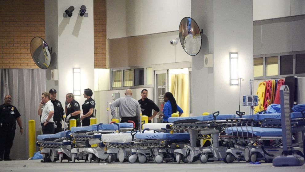 Emergency personnel wait with stretchers at the emergency entrance to Orlando Regional Medical Center hospital for the arrival of patients from the scene of a fatal shooting at Pulse Orlando nightclub in Orlando, Fla., Sunday, June 12, 2016.