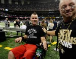 PHOTO: Former New Orleans Saints player Steve Gleason, who is suffering from ALS, is ushered onto the field before an NFL football game against the Philadelphia Eagles at the Mercedes-Benz Superdome in New Orleans, Nov. 5, 2012.