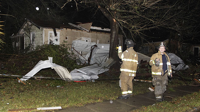PHOTO:Firefighters go door-to-door on North Carlen Street in the Midtown section of Mobile, Ala. after a tornado touched down Tuesday, Dec. 25, 2012.