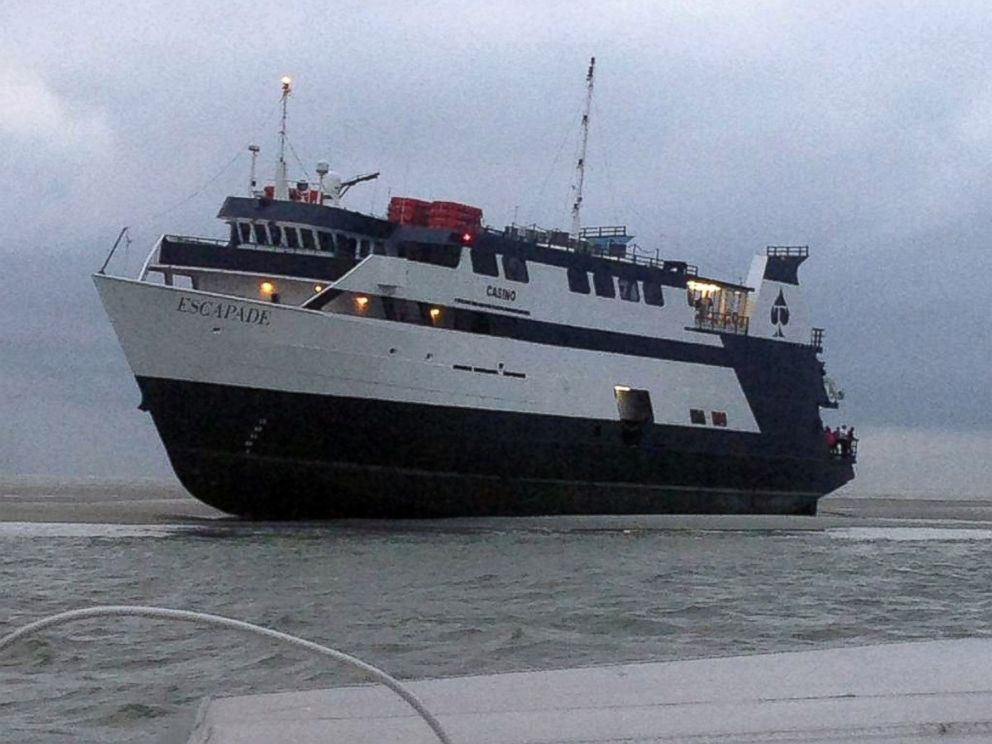 PHOTO: In this photo provided by the U.S. Coast Guard, the casino boat Escapade, with 123 people aboard, is grounded off the coast of Tybee Island, Ga., on July 16, 2014.