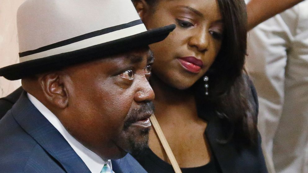 The Rev. Joey Crutcher, the father of Terence Crutcher, and his daughter Tiffany Crutcher, wait in a hallway in the Tulsa County courthouse for the arraignment of Tulsa police officer Betty Shelby in Tulsa, Okla., Sept. 30, 2016.