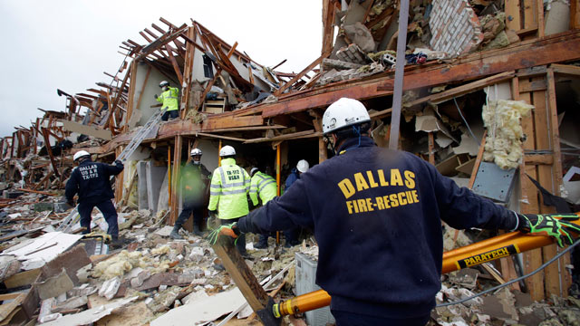 PHOTO: Firefighter conduct search and rescue of an apartment destroyed by an explosion at a fertilizer plant in West, Texas, April 18, 2013.