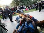 PHOTO: In this Nov. 18, 2011 file photo, University of California, Davis Police Lt. John Pike uses pepper spray to move Occupy UC Davis protesters while blocking their exit from the schools quad in Davis, Calif.