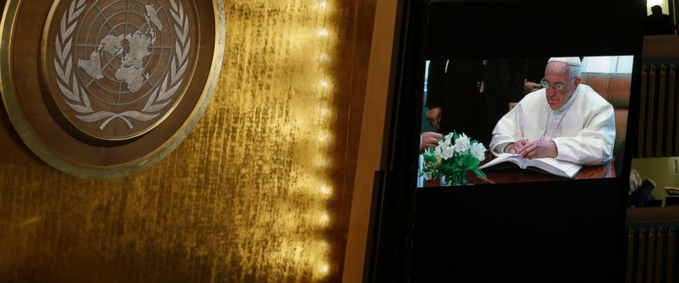PHOTO: Pope Francis is seen on a video monitor as he signs the United Nations guest book before addressing the General Assembly, Sept. 25, 2015 at United Nations headquarters.