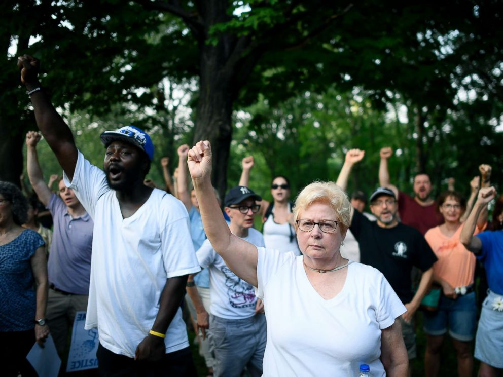 PHOTO: Jan Skogstrom, of Minneapolis, raises her fist with fellow protesters during a march in honor of Justine Damond at Beards Plaissance Park Thursday, July 20, 2017, in Minneapolis.