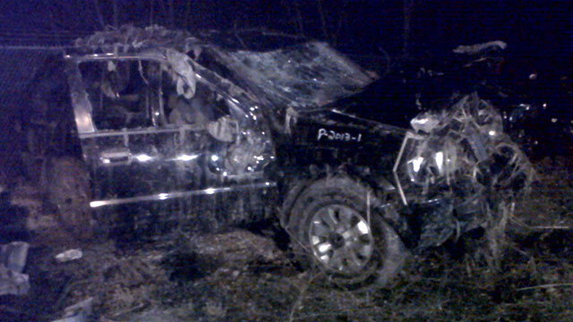 PHOTO: Honda Passport that crashed into a guardrail and flipped over into a swampy pond Sunday morning in Warren, Ohio, March 10, 2013.
