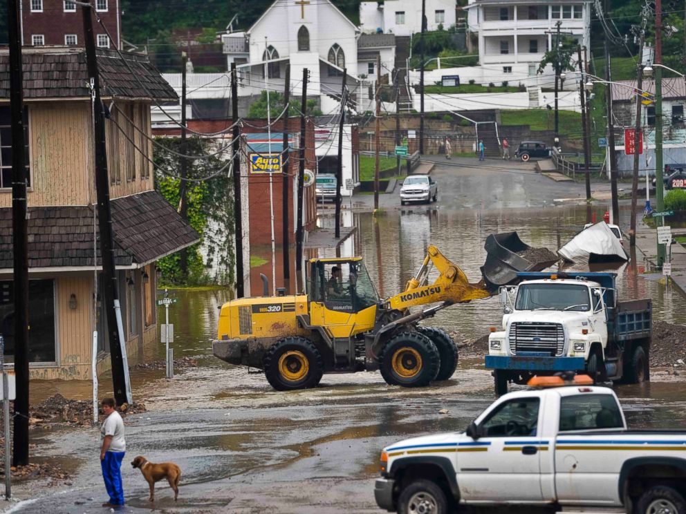 PHOTO: Residents begin clean up of flood damage on the lower portion of Oakford Avenue in Richwood, W.Va., June 24, 2016.