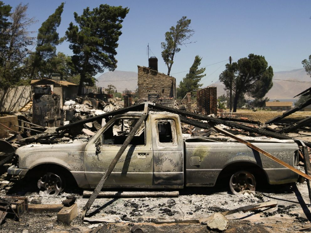 PHOTO: A pickup truck destroyed by a wildfire sits on a burned property, June 24, 2016, near Lake Isabella, Calif.