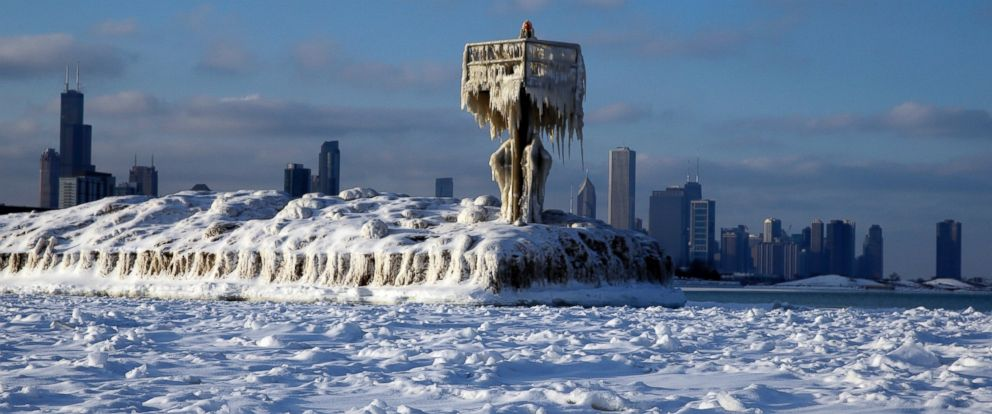 PHOTO: A harbor light is covered by snow and ice on the Lake Michigan at 31st Street Harbor, Sunday, March 1, 2015, in Chicago.