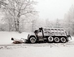 PHOTO: A snow plow rests in a ditch after sliding off of Brock Road in Spotsylvania, Va., March 6, 2013.