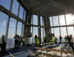 PHOTO: Members of the media tour the unfinished observation deck on the 100th floor of the One World Trade Center building, under construction in New York, April 2, 2013.