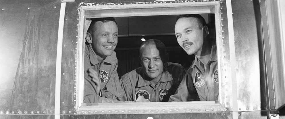 PHOTO: In this July 27, 1969, file photo, Apollo 11 crew members, from left, Neil Armstrong, Buzz Aldrin and Michael Collins sit inside a quarantine van in Houston.