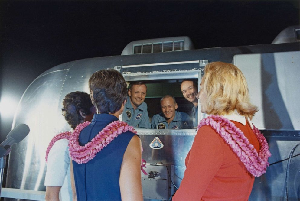 PHOTO: Crew members of NASAs Apollo 11 lunar landing mission are greeted by their wives after their arrival at Ellington Air Force Base in a Mobile Quarantine Facility earlier that day, July 27, 1969.
