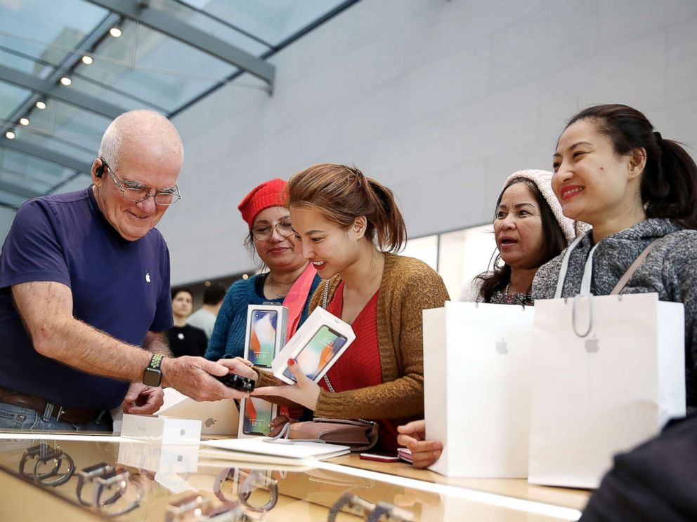 PHOTO: A customer purchases the new iPhone X at an Apple Store on Nov. 3, 2017, in Palo Alto, Calif.