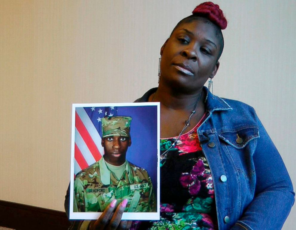 """April Pipkins holds a photograph of her deceased son, Emantic """"EJ"""" Bradford Jr., during an interview in Birmingham, Ala."""