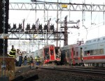 PHOTO: Emergency workers arrive the scene of a Metro North train collision, May 17, 2013 in Fairfield, Conn.