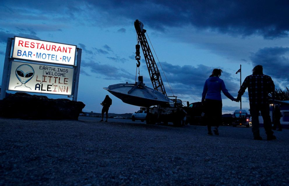 PHOTO: People walk near the Little ALeInn during an event inspired by the Storm Area 51 internet hoax, Thursday, Sept. 19, 2019, in Rachel, Nev.