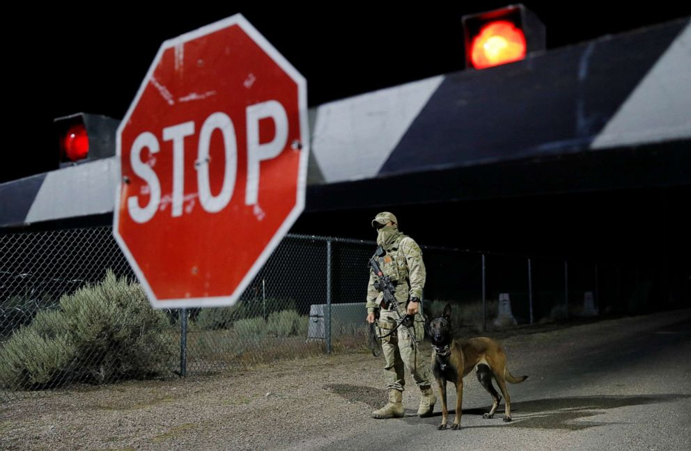 PHOTO: A security guard stands at an entrance to the Nevada Test and Training Range near Area 51 Friday, Sept. 20, 2019, near Rachel, Nev. People gathered at the gate inspired by the Storm Area 51 internet hoax.