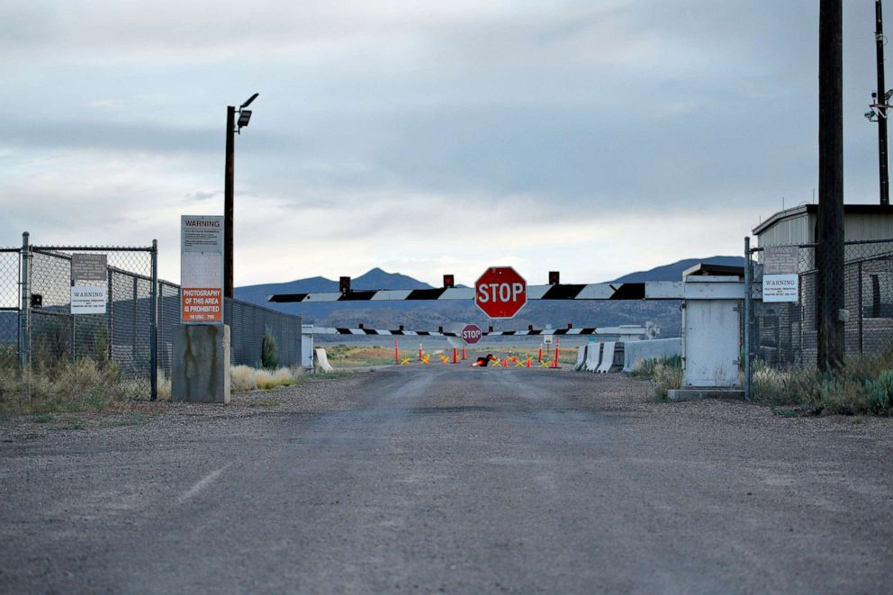 PHOTO: Signs warn about trespassing at an entrance to the Nevada Test and Training Range near Area 51 outside of Rachel, Nev.