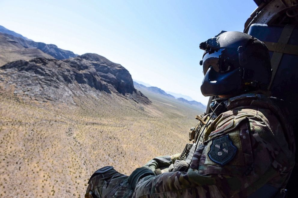 PHOTO: Staff Sgt. Christian Nault, 34th Weapons Squadron special mission aviator, searches the area for the landing zone during a Weapons School Integration mission at the Nevada Test and Training Range June 1, 2017.