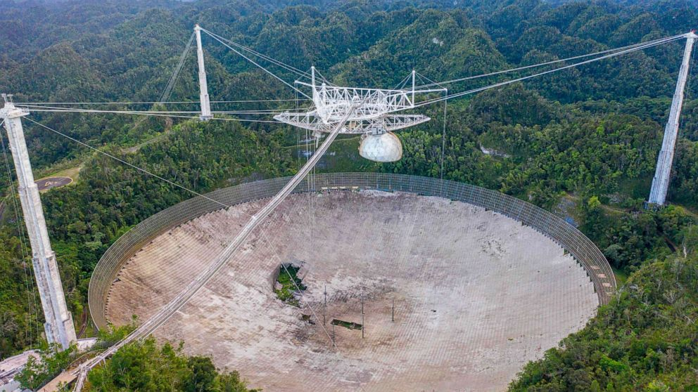 PHOTO: This aerial view shows a hole in the dish panels of the Arecibo Observatory in Arecibo, Puerto Rico, on Nov. 19, 2020.