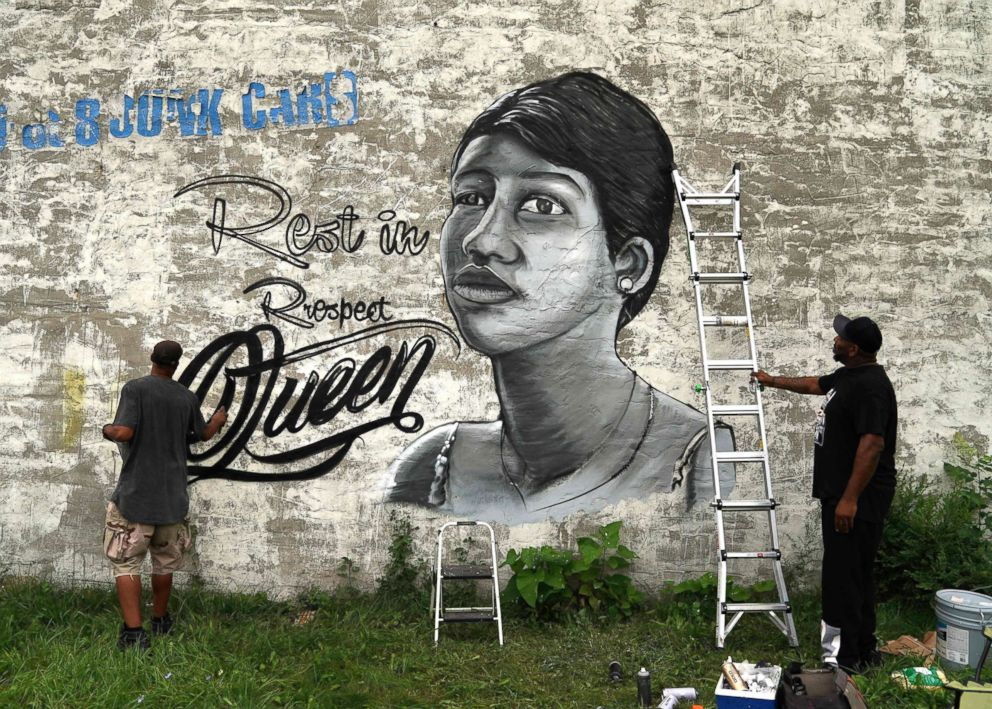 PHOTO: A man paints a mural of Aretha Franklin on a wall down the street where the Rev. Jesse Jackson spoke celebrating the life of singer Aretha Franklin at her fathers church, New Bethel Baptist, in Detroit, Aug. 19, 2018.