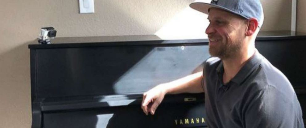 PHOTO: Aric Harding shows off his familys new piano.