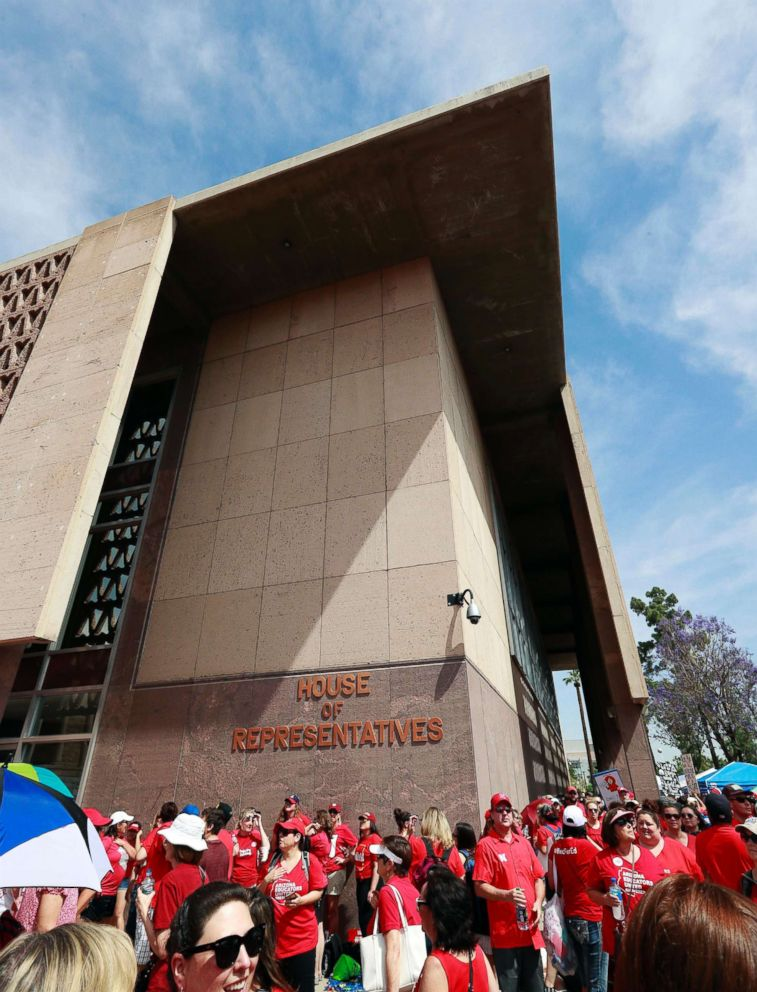 PHOTO: Teachers rally outside the Arizona House of Representatives Monday, April 30, 2018, in Phoenix on their third day of walk outs.