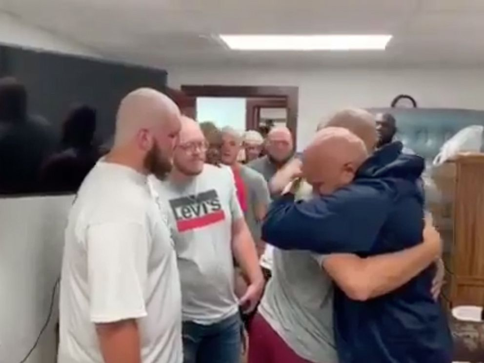 PHOTO: Member of the Lyons College football squad shaved their heads in support of the teams offensive coordinator, Kris Sweet, who was recently diagnosed with cancer.