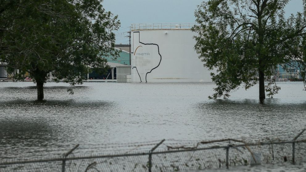 In this Aug. 30, 2017 photo, the Arkema chemical plant is flooded from Hurricane Harvey in Crosby, Texas, northeast of Houston. Nearby residents complain of a 'bitter taste' about the sparse information authorities provided when chemicals at the plant caught fire.