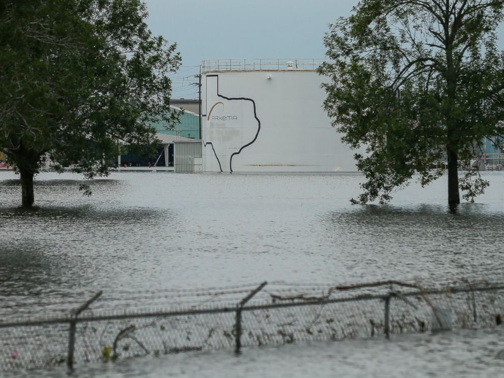 In this Aug. 30, 2017 photo, the Arkema chemical plant is flooded from Hurricane Harvey in Crosby, Texas. Nearby residents complain of a bitter taste about the sparse information authorities provided when chemicals at the plant caught fire.