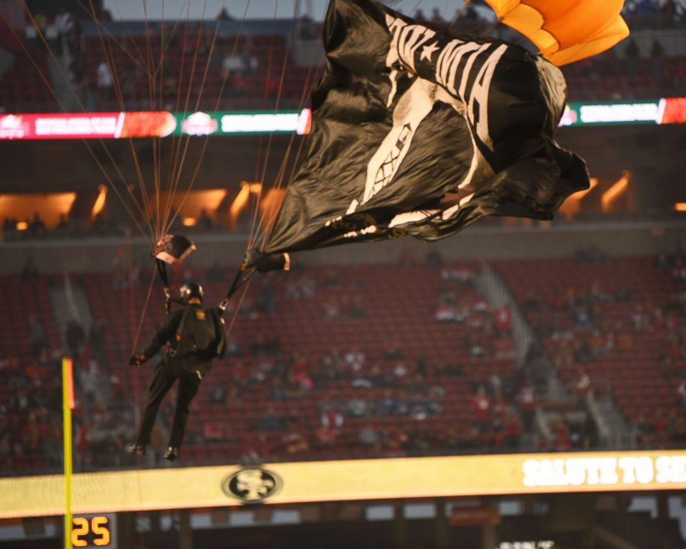 PHOTO: The U.S. Army Golden Knights Parachute team from Fort Bragg, N.C., jump into Levis Stadium prior to the San Francisco Forty-Niners and New York Giants Monday Night Football game in Santa Clara, Calif., Nov. 12, 2018.