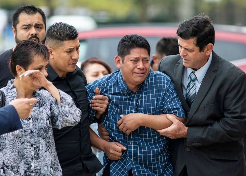 PHOTO: Arnulfo Ochoa, the father of Marlen Ochoa-Lopez, is surrounded by family members and supporters, as he walks into the Cook County medical examiners office to identify his daughters body, May 16, 2019, in Chicago.