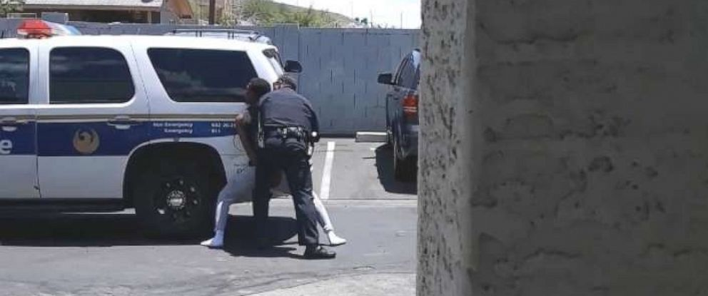 PHOTO: Cell phone video shows officers from the Phoenix Police Department sweep-kicking handcuffed Dravon Ames, May 27, 2019.