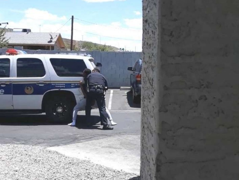 PHOTO: A video on a cell phone shows police officers from the Phoenix Police Department handcuffing Dravon Ames on May 27, 2019.