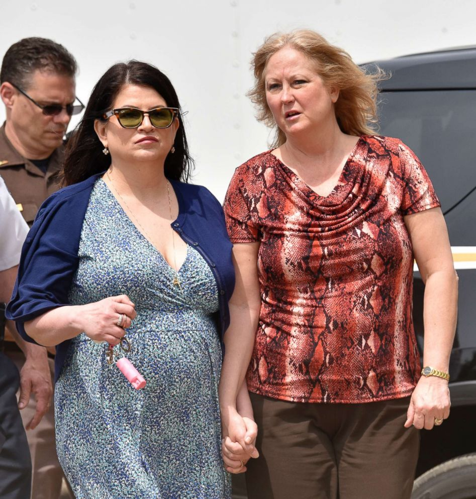 PHOTO: Annie Godbout, in dress, the best friend of Kimberly King and Konnie Beyma, Kimberlys sister, walk to a press conference in Macomb Township, Mich., May 9, 2018.