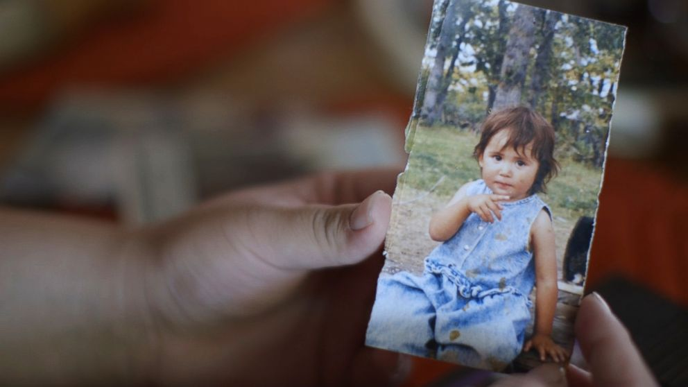 <div>Kimberly Loring holds a childhood portrait of her sister, Ashley Loring HeavyRunner, who has been missing since June 2017.</div>
