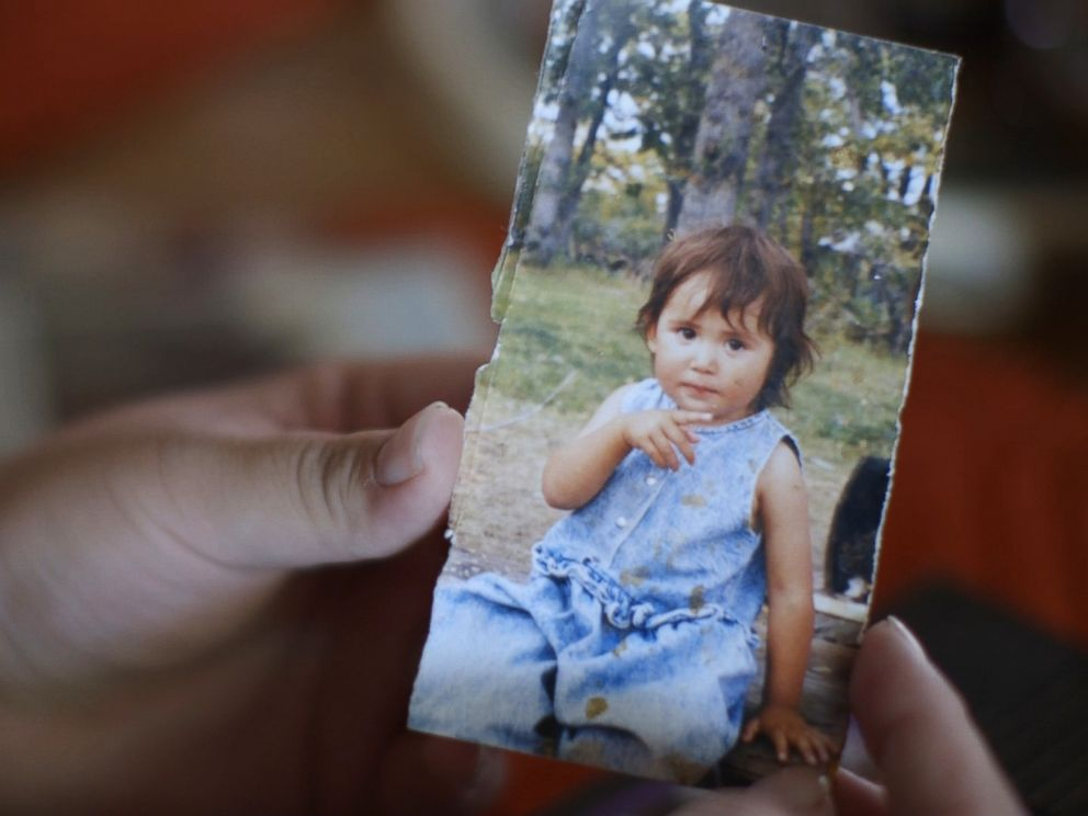 PHOTO: Kimberly Loring holds a childhood portrait of her sister, Ashley Loring HeavyRunner, who has been missing since June 2017.