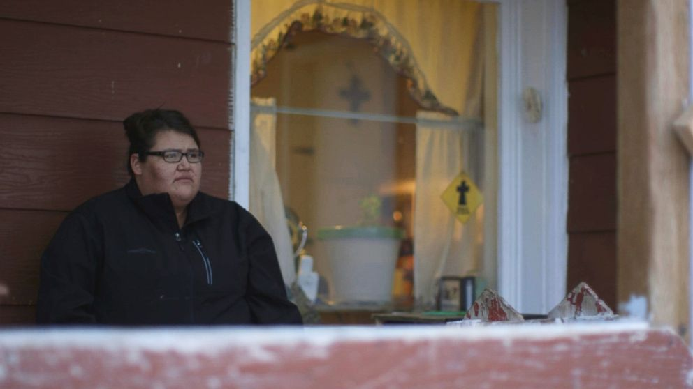 Kimberly Loring sits on the porch of her grandmother's ranch.