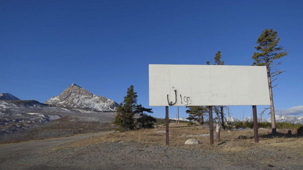 Graffiti adorns an empty billboard outside the town of St. Mary's on the Blackfeet Reservation in Montana.