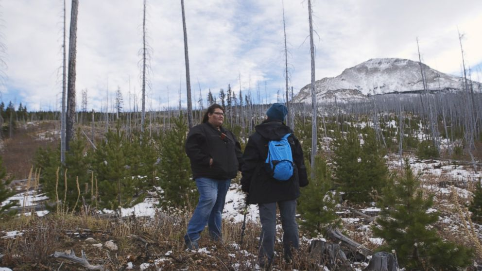 Kimberly Loring and a volunteer stop to catch their breath while searching for Ashley Loring HeavyRunner in the Rocky Mountains.