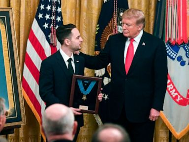 PHOTO: President Donald Trump presents a posthumous Medal of Honor for Army Staff Sergeant Travis Atkins, to his surviving son Trevor Oliver, during a ceremony in the East Room of the White House in Washington, DC, March 27, 2019.