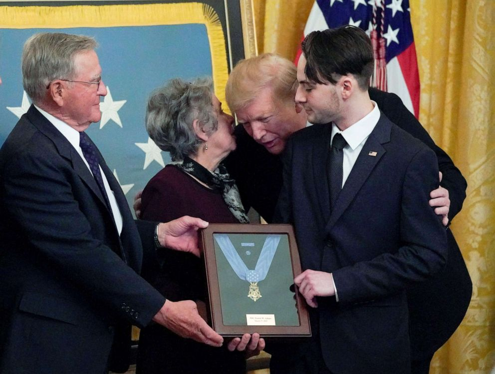 PHOTO: President Donald Trump leans in to talk with John and Elaine Atkins, the parents of the late Army Staff Sgt. Travis Atkins, as he presents them with the Medal of Honor in recognition of the battlefield actions in Washington, March 27, 2019.