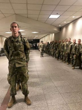 PHOTO: Accompanied by their drill instructors Army recruits from Fort Benning, Georgia arrive at Atlantas Hartsfield-Jackson International Airport headed home for the holidays.